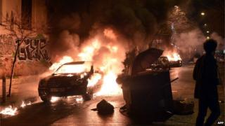 A burning car in central Athens' Exarchia district on 26 February 2015