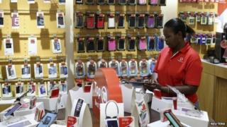 Female worker in Johannesburg South Africa in Vodacom shop
