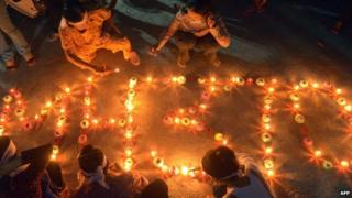 People write out MH370 in candles