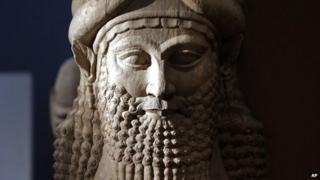 Detail of a statue from the Assyrian period displayed at the Iraqi National Museum in Baghdad
