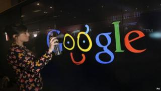 A customers tries the digital spray wall at the new Google store
