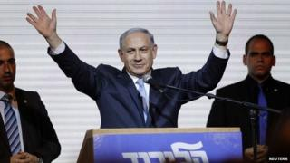 Israeli Prime Minister Benjamin Netanyahu waves to supporters at the party headquarters in Tel Aviv March 18, 2015