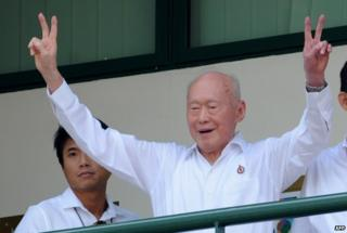 Lee Kuan Yew gives the victory sign to his supporters in April 2011