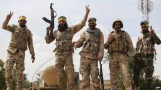 Shia militiamen celebrate after Iraqi government forces recapture Tikrit (1 April 2015)