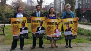 """From left to right: Mary Sithole, S Chelvan, Lois Lau and Nicolette Moonen with """"I am an immigrant"""" posters"""