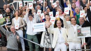 Urgenda Foundation director Marjan Minnesma with plaintiffs in case against the government