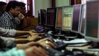 Male stock market traders in India