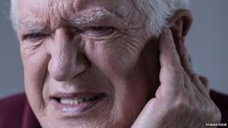 man touching ear