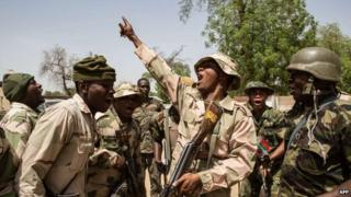 Nigerian troops celebrate after taking over Bama from Boko Haram on 25 March