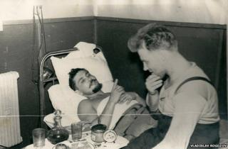 Leonid lying down talking to his friend Yuri Vereschagin