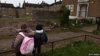 Children sat in council estate