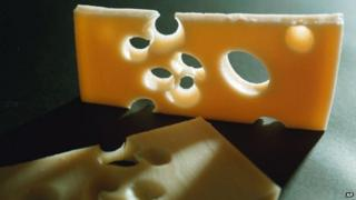 This undated file photo shows two slices of the famed Swiss Emmental cheese.