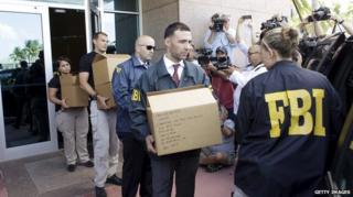 FBI investigators remove documents after the arrests of several senior Fifa officials
