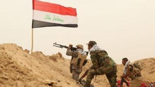 Fighters from the Badr Brigades Shia militia clash with Islamic State outside Fallujah
