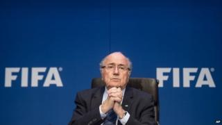 FIFA President Sepp Blatter (with hands clasped together, giving appearance of praying) attends a news conference following the FIFA Executive Committee meeting in Zurich, Switzerland, on Saturday, May 30, 2015.