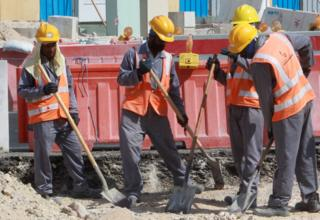 Workers at work on the Qatar construction site