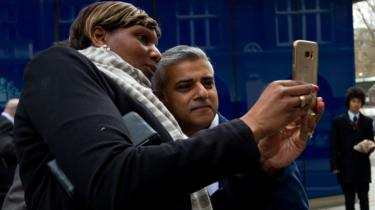 Sadiq Khan poses for a selfie on the campaign trail
