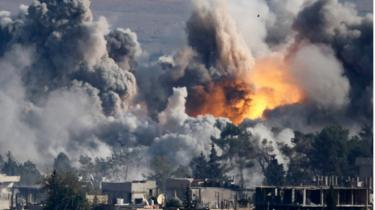 US-led coalition air strike on the northern Syrian town of Kobane (18 October 2014)