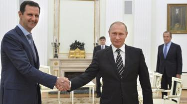 Russian President Vladimir Putin shakes hands with Syrian President Bashar al-Assad at the Kremlin in Moscow (20 October 2015)