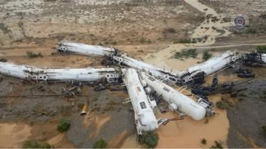 Derailed freight train carriages carrying sulphuric acid