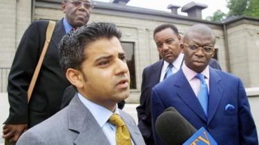 Sadiq Khan, solicitor instructed by Nation of Islam in London, speaks briefly to the media outside a schedules press conference August 16, 2001 in Chicago