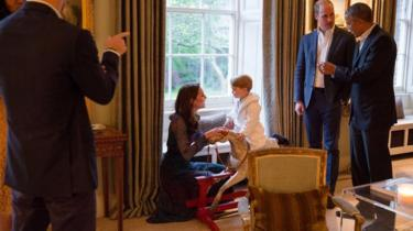 Prince George on a rocking horse with his mother, the Duchess of Cambridge
