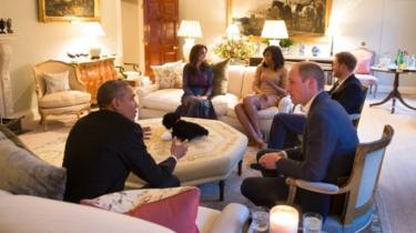 Barack and Michelle Obama chatting with the Duke and Duchess of Cambridge and Prince Harry in Kensington Palace