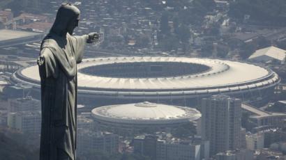 The Christ the Redeemer statue stands above Maracana stadium in Rio de Janeiro