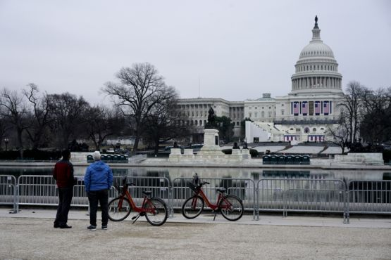 Tourists watch the set-up for President-elect Donald Trump's inauguration.