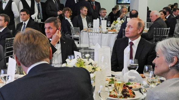 In this file photo taken on Thursday, Dec. 10, 2015, Russian President Vladimir Putin, center right, with retired U.S. Lt. Gen. Michael T. Flynn, center left,