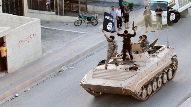 Islamic State militants in Raqqa on 30 June 2014