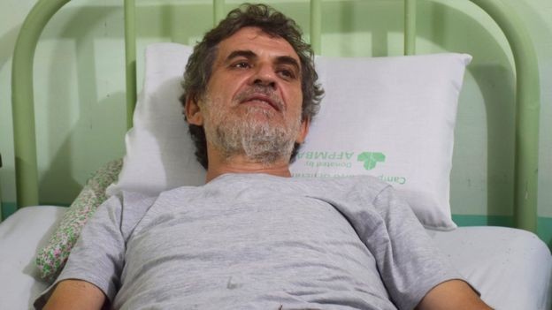 former Italian missionary Rolando Del Torchio waits for medical treatment at the Trauma Center Zamboanga city hours after his release from suspected Abu Sayyaf