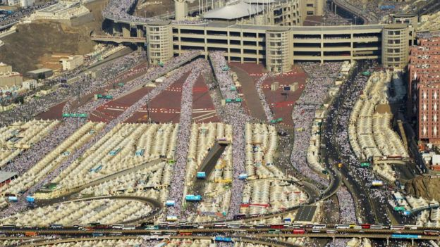 hundreds of thousands of Muslim pilgrims make their way to cast stones at a pillar symbolizing the stoning of Satan in Mina, Saudi Arabia, Thursday, Sept. 24, 2015.