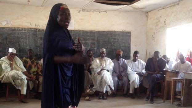 A woman speaks during community leaders meeting in Nigeria's Adamawa state