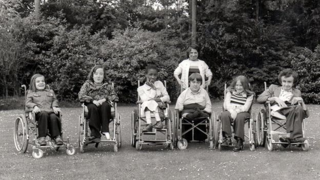 Seven young people from Banstead, six in wheelchairs