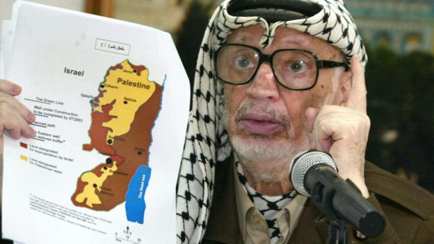 Yasser Arafat with a map of the West Bank (file photo)