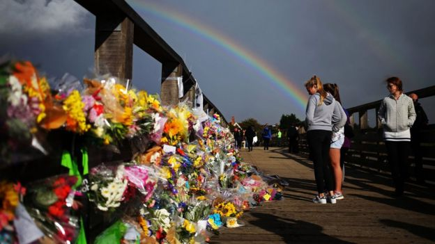 Floral tributes on a bridge near the A27