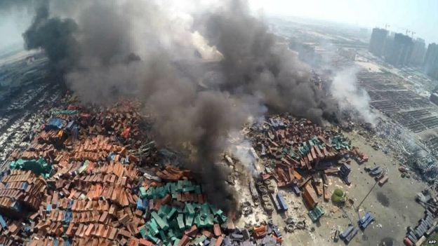 Plumes of smoke at scene of explosions in Tianjin, China. 14 Aug 2015
