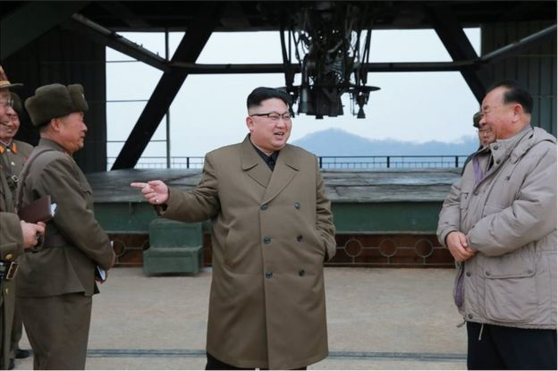 Picture of Kim Jong-un at a rocket engine test site in a photo released on 19 March 2017