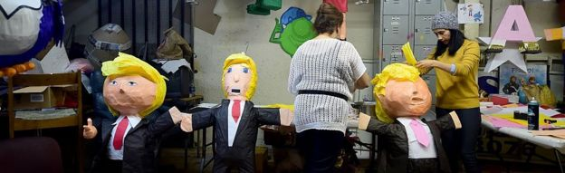Finishing touches are made to a paper-mache pinata of presumptive Republican nominee for US President, Donald Trump