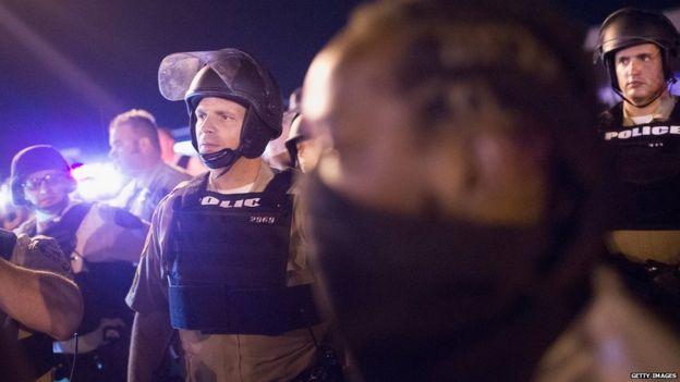 Police in Ferguson on 11 August 2015