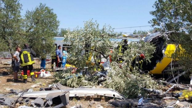 A handout picture provided by the Italian Fire Brigade shows emergency services working at the crash site where two trains collided in southern Italy