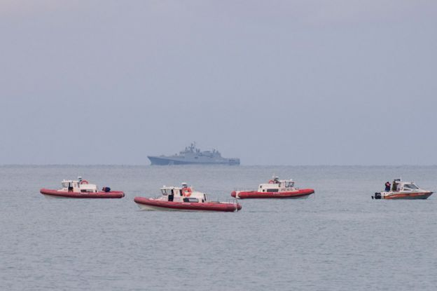 Russian rescue boats patrol off the coast of the Black Sea city of Sochi looking for debris of a Russian military plane, 26 December
