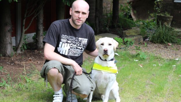 Simon Wheatcroft and Ascot guide dog