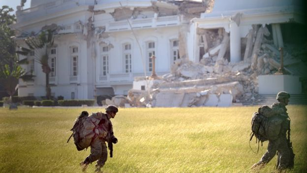 A platoon of US paratroopers inserted by helicopters secures the heavily damaged presidential palace in Port-au-Prince January 19, 2010.