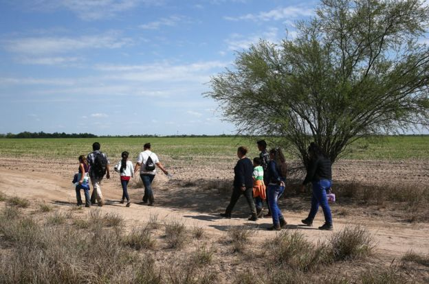 Families crossing from Mexico to US