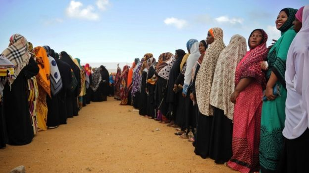 Tanzanian women queue to cast their ballots at a polling station on 25 October2015 in Zanzibar