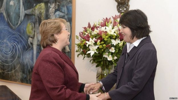 Chile's President Michelle Bachelet (L) meets with Carmen Gloria Quintana, who suffered serious injuries when she was set on fire during a Santiago labour strike on July 2, 1986, at the government palace in Santiago, Chile, July 30, 2015,