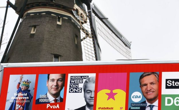 Election poster billboard seen near a windmill in Amsterdam, Netherlands, March 14, 2017