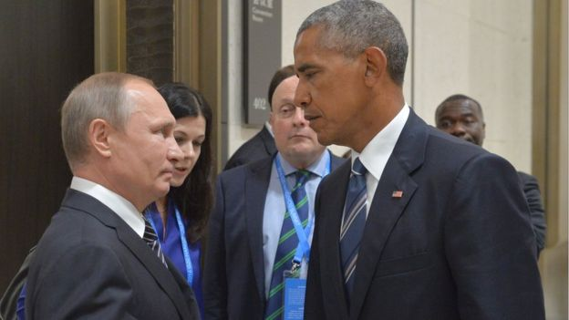 Russian President Vladimir Putin, left, speaks with U.S. President Barack Obama